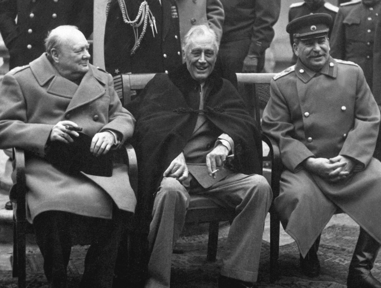 """Big Three"" at Yalta in February 1945: Prime Minister Winston Churchill, President Franklin D. Roosevelt, and Premier Josef Stalin. Source: National Archives and Records Administration, Public domain."