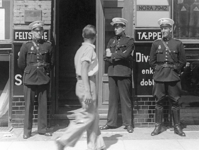 Police officers in front of Communist Party headquarters, Copenhagen 1941. Source: National Museum of Denmark. Flickr - No known copyright restrictions